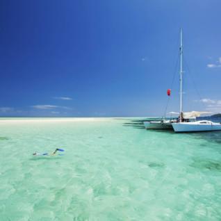 Snorkelling alongside sailing boat, Fiji