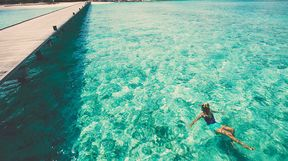 Swimming in clear ocean, Maldives