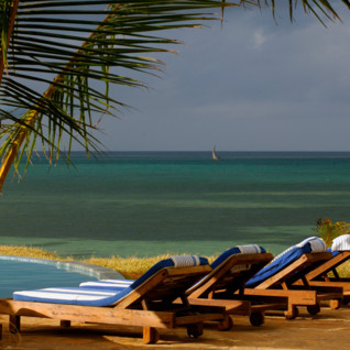 Pool with ocean view at Fumba Beach Lodge, luxury hotel in Tanzania
