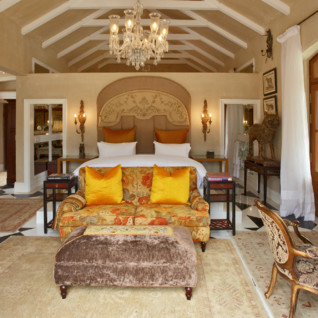 Large bedroom at La Residence, luxury hotel in South Africa