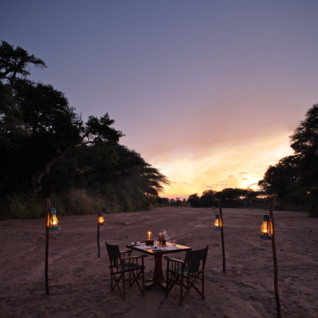 Dinner on the sandriver at Jongomero, luxury hotel in Tanzania