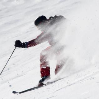 A Skier Speeding through the Snow
