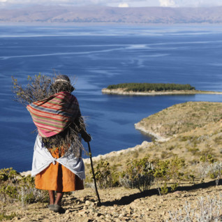 Bolivian Woman Walking along the Clifftop - Lake Titicaca