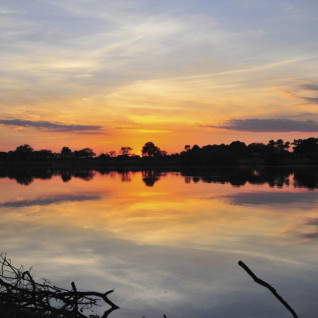 Reflections in the Zambezi River at sunset