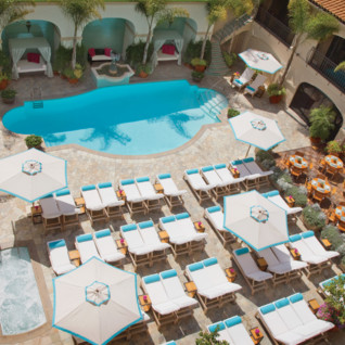 The pool area at Four Seasons Beverly Wilshire, luxury hotel in Los Angeles