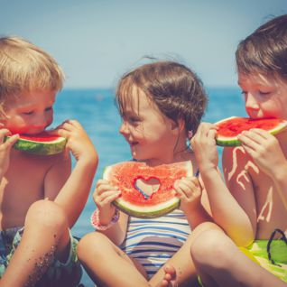 Children Eating Watermelon, European Beach