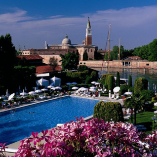 View across hotel pool from Hotel Cipriani, luxury hotel in Italy