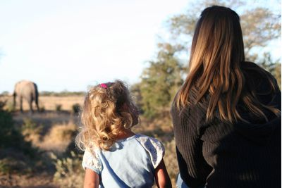 Mother and daughter on elephant safari