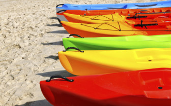 Kayaks Lined Up On The Beach