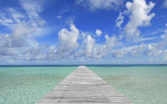 A Pier Leading Into The Indian Ocean