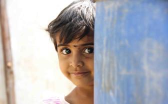 Girl peeking round wall
