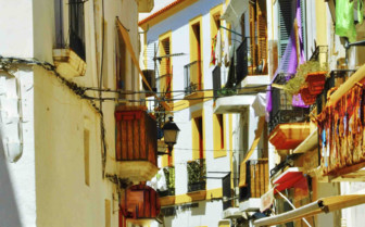 A Tiny White and Yellow Street in Ibiza