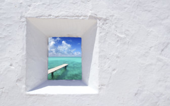 A Glimpse of the Sea Through a Window in a White Wall