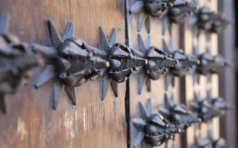 Metal Detailing on a Wooden Door in Valencia