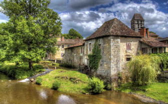 House alongside a stream