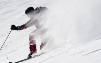 A Skier Speeding through the Snow