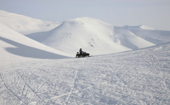Snowmobile in the Arctic Circle