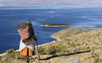 Bolivian Woman Walking along the Clifftop
