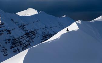 Skiing through the Mountains near Deplar Farm, Iceland