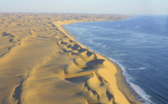 The sand and sea of the coast of Namibia