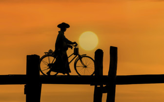 U Bein Bridge silhouette and bicycle