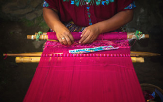 Woman Folding Textiles