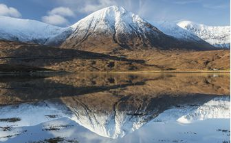 A lovely snow capped mountain reflection