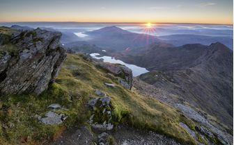 A view of Snowdonia National Park at sunset