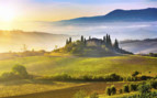 Misty sunrise over Tuscany