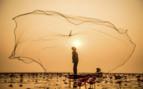 Myanmar fisherman and net
