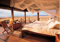 Luxury bedroom at Wolwedans Dunes Lodge, luxury lodge in Namibia