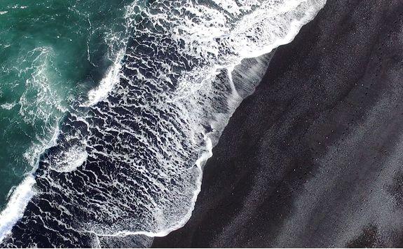 Black sandy beach