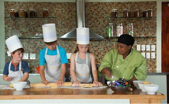 Kids baking in the kitchen at Ecca Lodge