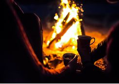 Drinks at a campfire