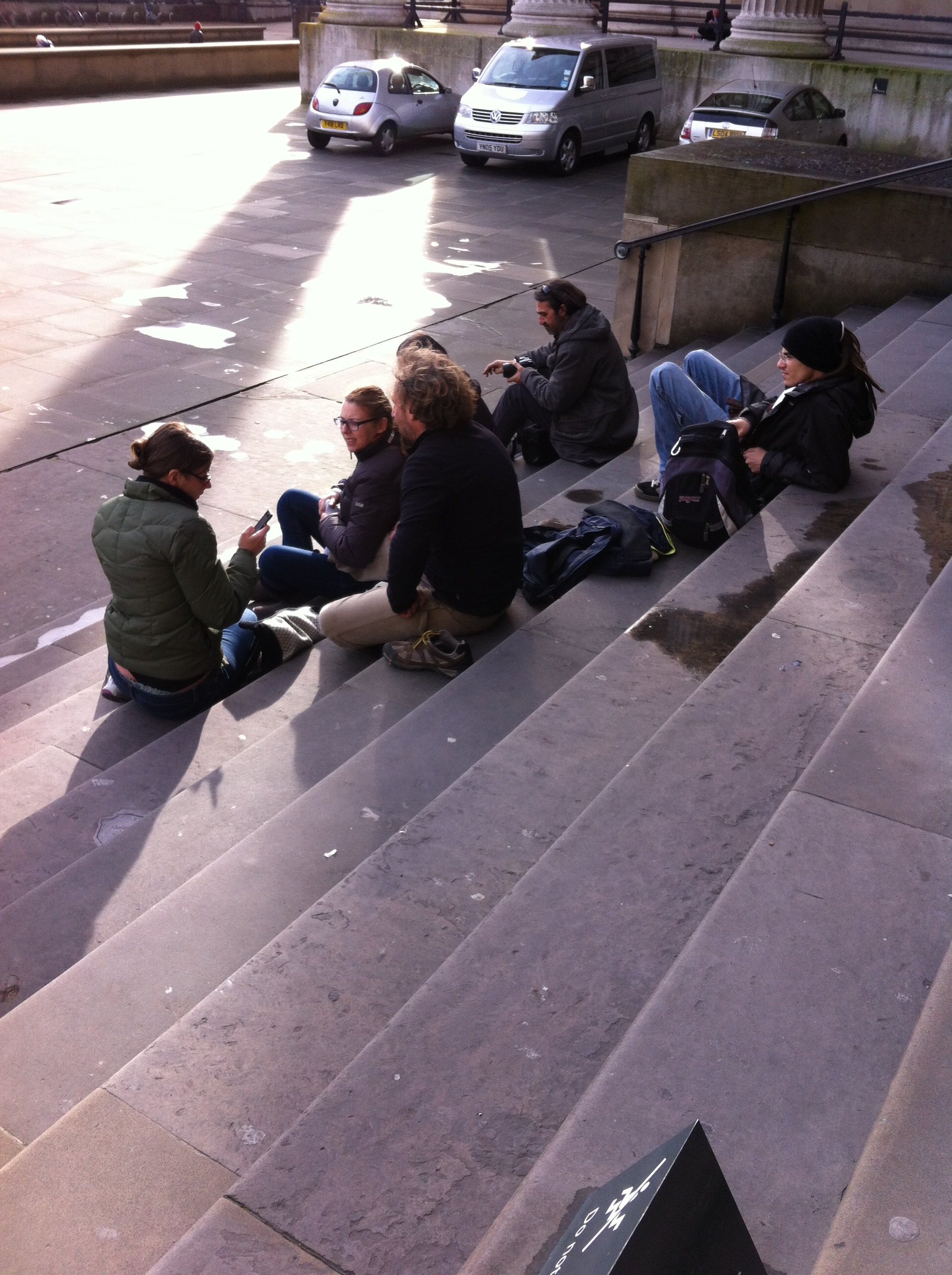 Tourists sitting on the steps of the British Museum
