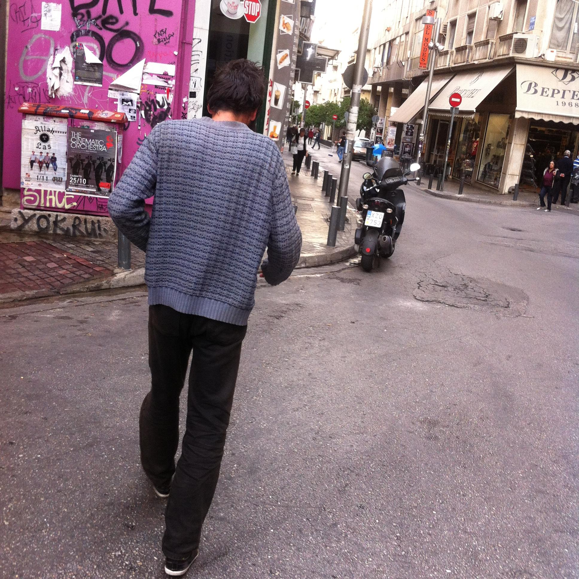 We followed the man smoking a cigarette