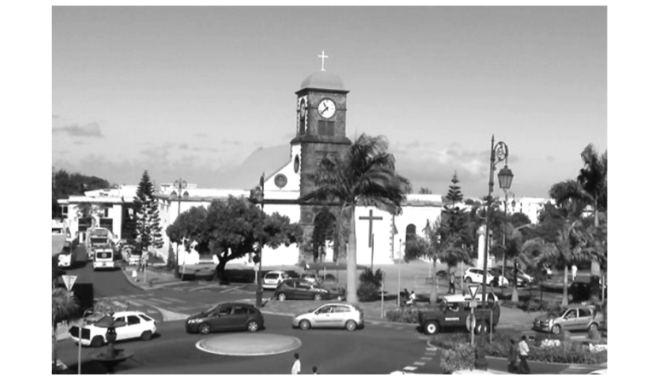 This is the town center. On the picture, we can see the church in the background. C