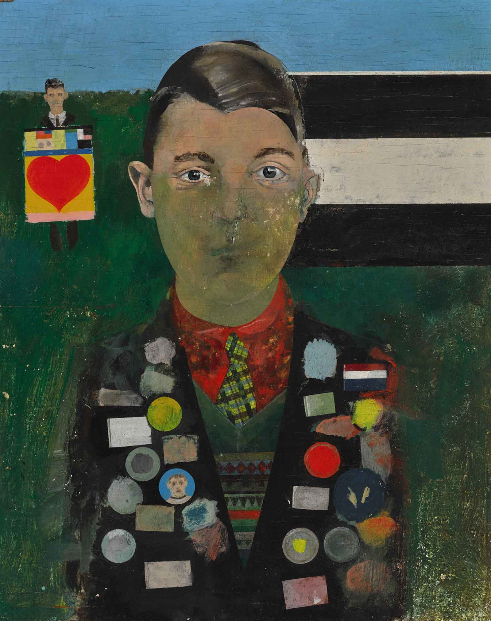 A boy wearing a jacket covered in badges stands against a green background with another man holding a painting of a heart behind him.