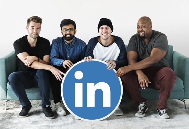People holding a Linkedin logo