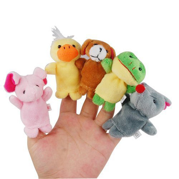 Hand with soft animal finger puppets