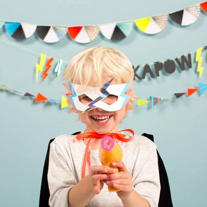 Superhero party, boy wearing superhero mask