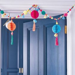 Boho pom pom garland over door