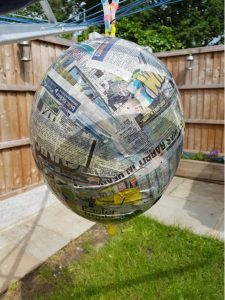 Paper mache hanging to dry