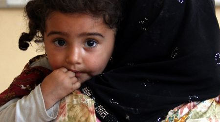Hazar * with Mirah *, 2, Fayda Secondary School in Iraq where displaced families are staying. Hazar is heavily pregnant.