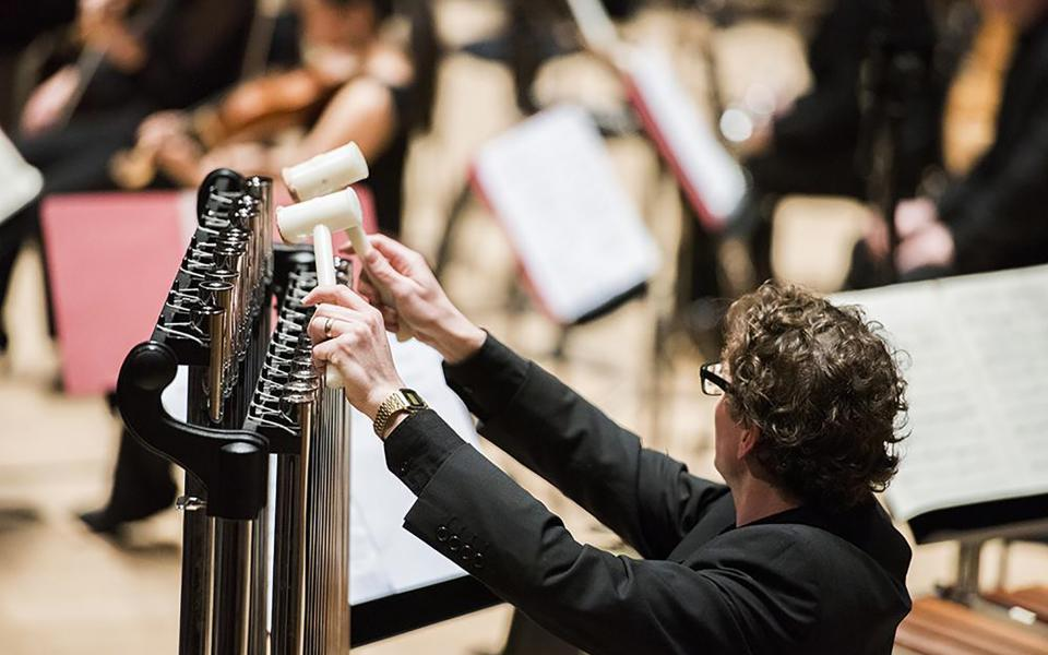 A percussionist playing the tubular bells