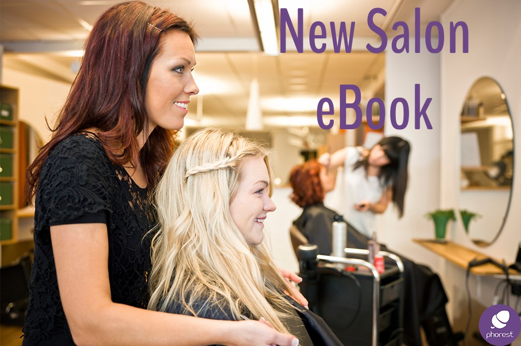 Stylist and customer performing consultation.