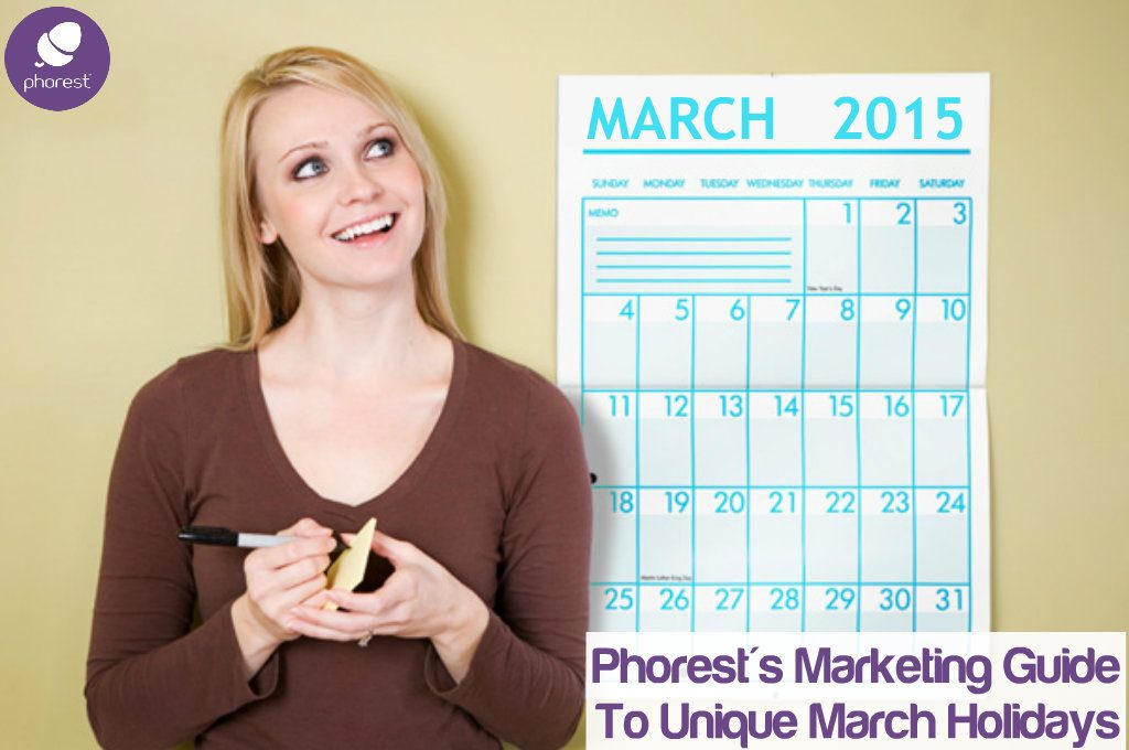 woman writing on post it near march calendar