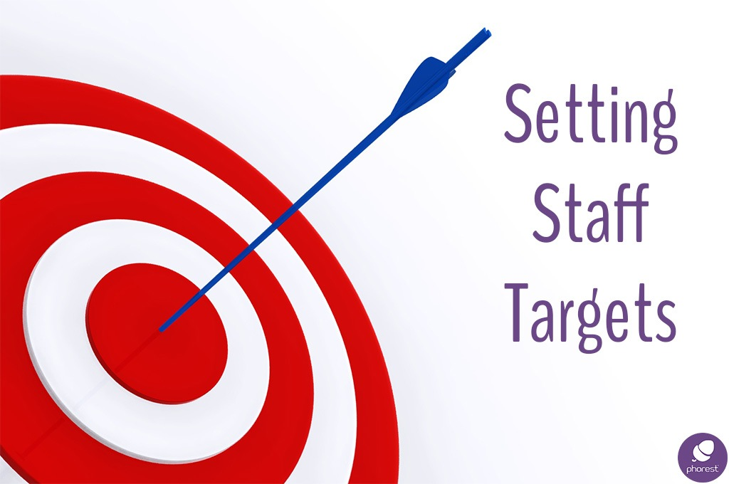 Setting staff targets. Arrow in a bullseye