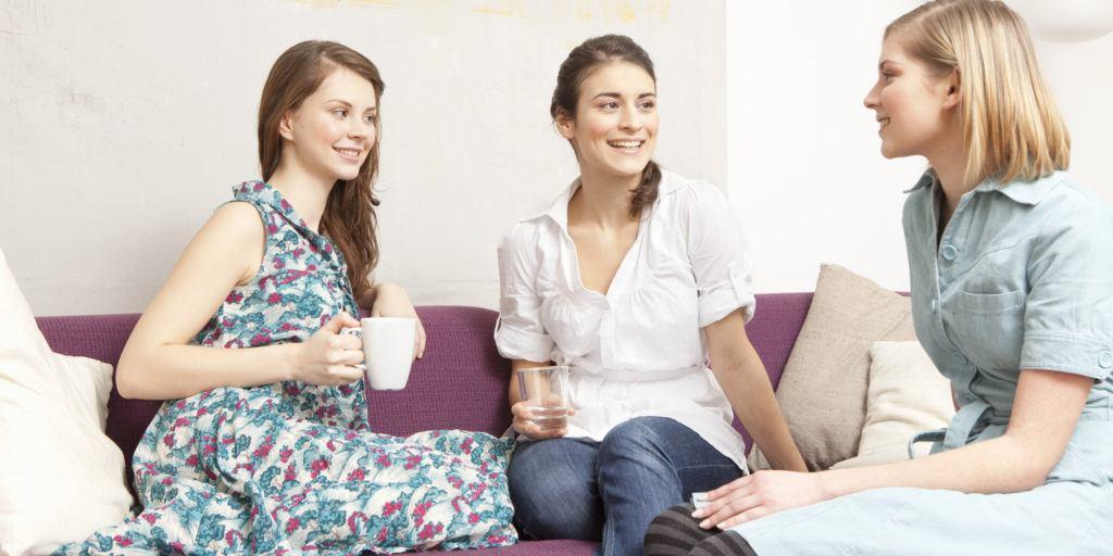3 women enjoying a coffee morning on the sofa
