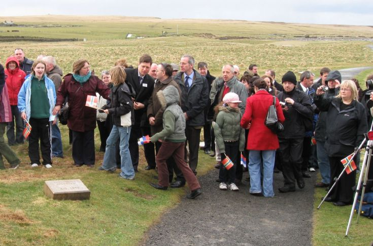 Throng at unveiling of new timeline stone